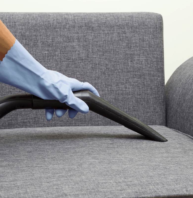 Couch being vacuumed